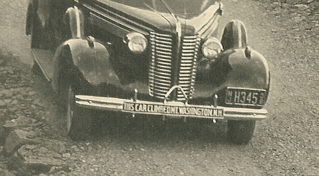 This is a blow-up of an old promotional photo from the 1930's showing that at least that far back we were using the early rendition of the now famous bumper sticker. From Flickr