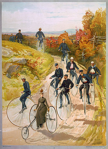 """Bicycling"", a ca. 1887 color print showing one of the few ways in which it was socially acceptable for women to ride cycles, in the years before the invention of ""safety bicycles"" and the woman's ""bicycle suit"""